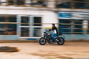 photo of man riding a motorcycle