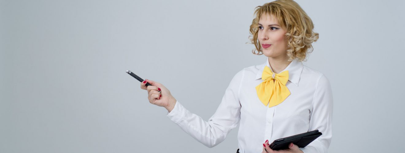 portrait of young woman against white background teacher 標點符號:教育部中文標準符號教學手冊