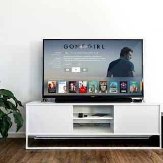 black flat screen tv on white wooden tv rack in living room design 國外自助旅行 7 大電源插座及插頭詳細說明 內附各國電壓規範與插頭圖表