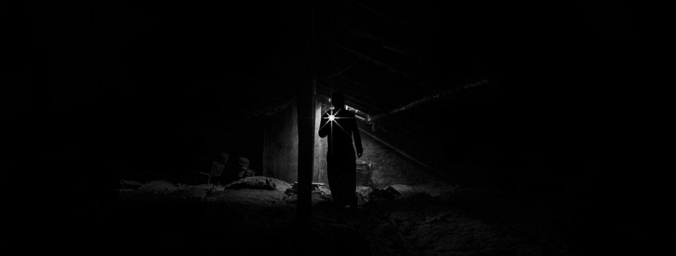 light lamp low angle view of man standing at night 深夜中被鎖大門外的心酸與淚 —— 月色下的網咖迎客去