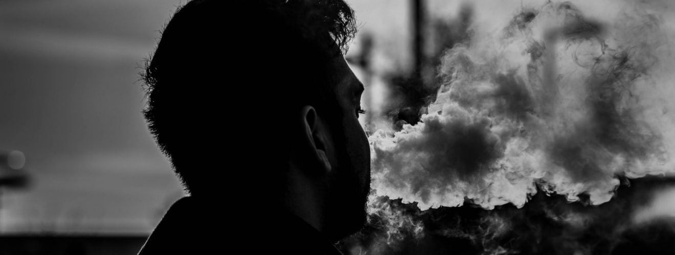 grayscale photography of man smoking 從日常生活著手愛地球 靠這 6 招環保減碳、清霧霾 PM2.5 少污染顧健康