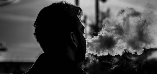 grayscale photography of man smoking 3
