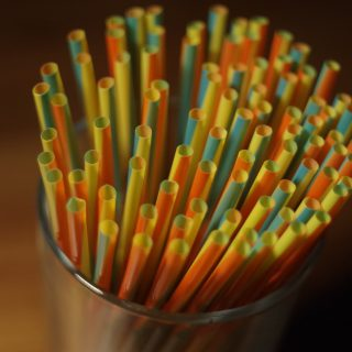 colorful plastic straw on a glass container 3