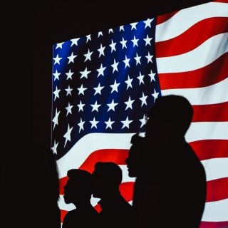 silhouette of people beside usa flag america government 3