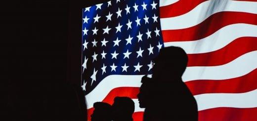 silhouette of people beside usa flag america government 歐威爾主義(歐威爾式)的真正含義