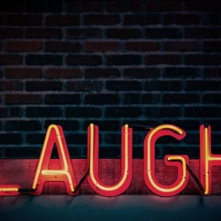 laugh neon light signage turned on brick wall joke 台灣最不怕上法院的男人|字體笑話