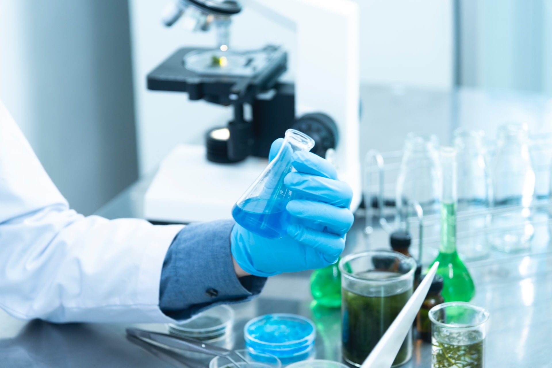 biochemistry biology microscope researcher holding Beaker Sterilization laboratory 1
