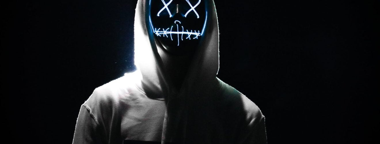 person s gray hoodie mask